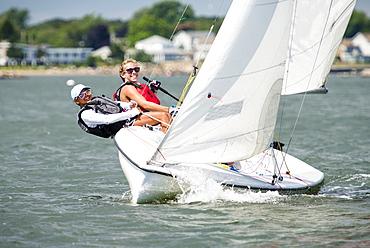 Two Juniors Sailor Sailing Sail Boat In Narragansett Bay For Junior Sailing Program