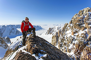 Mountaineer Daniel Bull Standing On Top Of Mountain In Snowy Landscape