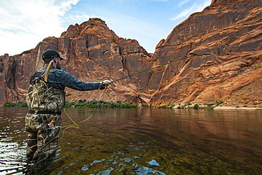 Man Fly Fishing During Sunset On The Colorado River In The Grand Canyon