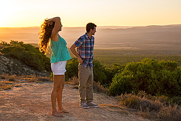 Man And Woman Watch The Sunset Over Addo Elephant National Park In South Africa