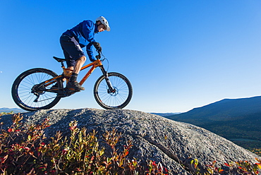 Mountain Biker Riding On The Rocky Landscape Of Whitehorse Ledge, New Hampshire