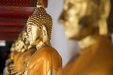 Row Of Golden Buddha Statues At The Wat Pho Temple, Bangkok, Thailand