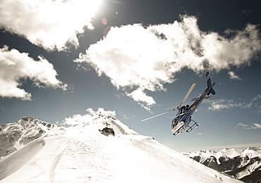 Helicopter Flying Over Silverton Mountain Ski Resort