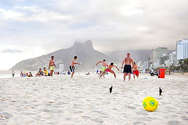 Group Of Men Playing Soccer On Ipanema Beach