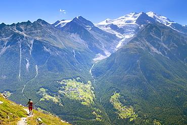 A Hiker Descending From The Augstbordpass Into The Matterhorn Valley