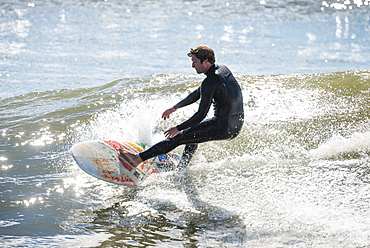 Man Surfing On The Wave Of Rhode Island In New England, Usa