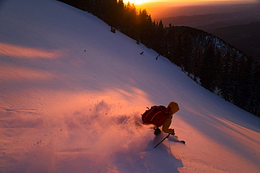 Brody Leven Skiing Down La Sal Mountains During Sunset In Utah