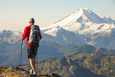 Man Hiking In North Cascades National Park With View Of Mount Baker