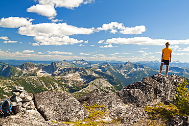 A Hiker Stands On The Summit Of Vicuna Peak, British Columbia, Canada