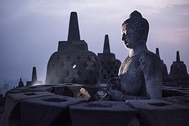 Buddha Statue At The Borobudur Temple In Java, Indonesia