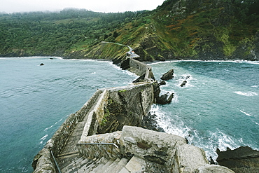 View Of The Islet Of Gaztelugatxe Connected To The Mainland By A Man-made Bridge
