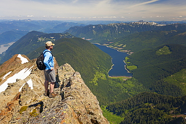 Hiker looking down on Jones Lake from top of Lady Peak in Cheam Mountain Range