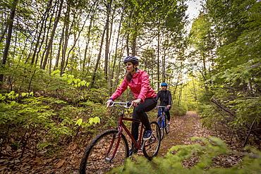 A Couple Mountain Biking On A Forest Trail Near Stonehouse Pond In Barrington, New Hampshire