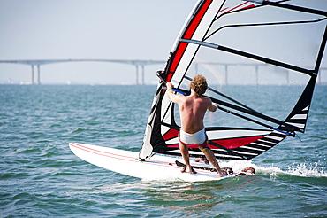 Man windsurfing on a sunny summer day in Rhode island