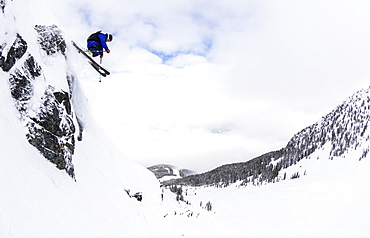 A Man Skis Deep Powder On A Stormy Day At Whistler Blackcomb Ski Resort In British Columbia