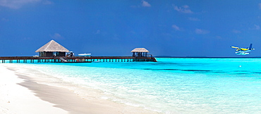 Tropical resort with stilt huts in sea
