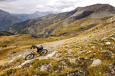 A Mountain Biker In The Backcountry Of Mercantour National Park, France
