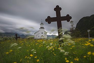 Flower filled cemetery at Gimsøy church, Gimsøy, Lofoten Islands, Norway