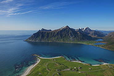 View over beaches and village of Flakstad from Flakstadtind mountain peak, Flakstadøy, Lofoten Islands, Norway
