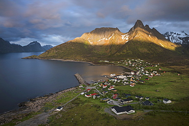 Summer light over mountains above village of Mefjordvær, Senja, Norway