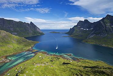 Passenger ferry arrives at isolated village of Vindstad, Moskenesøy, Lofoten Islands, Norway