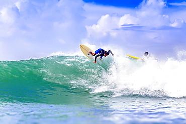 Male surfer on wave