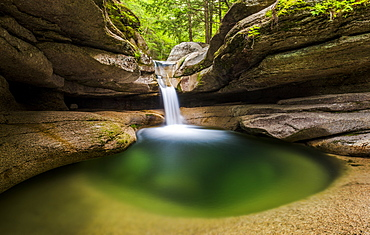 An emerald green pool at the top of Sabbady Falls in New Hampshire.