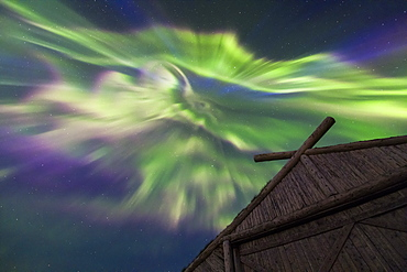 The Northern Lights over a boathouse at Norstead Viking replica village in Newfoundland.