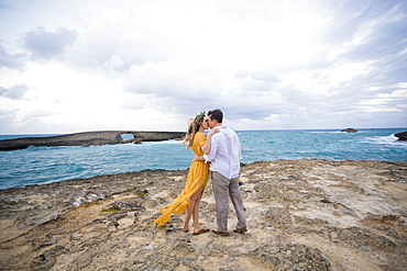Engaged couple portrait on the beach at North Shore Oahu Hawaii in the Spring.