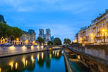 Seine River at dawn with Notre Dame Cathedral in the distance, in the neighborhood of Saint-Michel, Paris, France