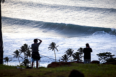 Spectators watching big surf at Waimea Bay, on the north shore of Oahu.
