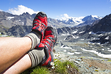 Trail running shoes are resting in the mountains of Switzerland. Halfway the Haute Route, a classic multi day hike in Switzerland.