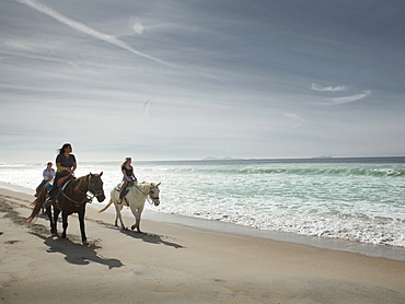 Horseriders stroll a beach in Imperial Beach, California near the Mexican border.