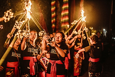 People holding torches with fire in preparation for celebration event, Tabanan, Bali, Indonesia