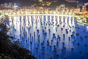 View from Sugar Loaf Mountain during dusk to Botafogo Beach in Rio de Janeiro, Brazil