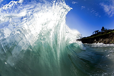 An ocean wave after being collided into by another wave on the East side of Oahu, Hawaii.