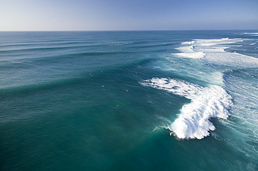 An overview of perfect surf at Sunset Beach, on the north shore of Oahu.