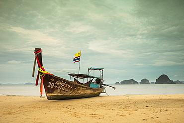 Long-tail boat moored on beach during daytime, Krabi, Krabi Province, Thailand
