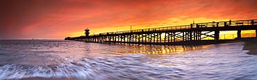 Long exposure panorama of waves and pier at seal Beach, Orange County, California, USA