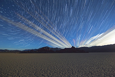 Beautiful scenery with star trails above desert, Death Valley, California, USA