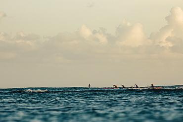 Men paddling in sea, Kaimana Beach, Honolulu, Hawaii, USA