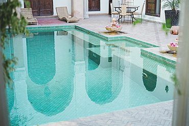 Photograph of empty swimming pool in Moroccan riad, Marrakech, Morocco