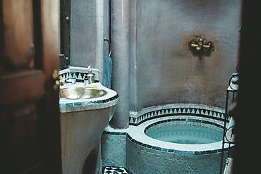 Details of Arabian bathroom with sink and bathtub, Marrakech, Morocco