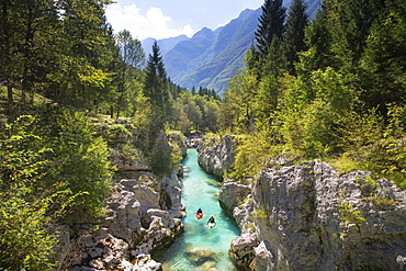 Kayakers on Soca river originating in Trigval mountains. The river is famous for all kinds of white water activities, Triglav National Park, Slovenia