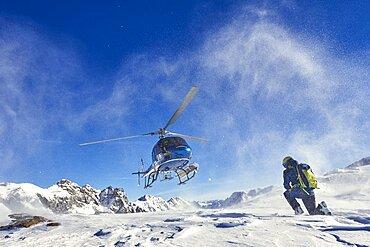 Skiers doing heliskiing in Formazza Valley, Piedmont, Italy