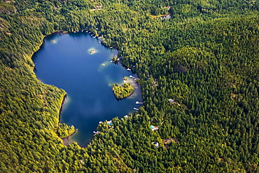 Aerial view of Levette Lake surrounded by forest, Whistler, British Columbia, Canada
