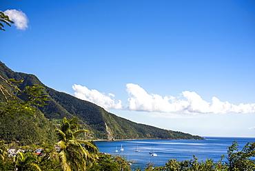 Scenic view of coastline with sailboats in sea, Basse Terre, Guadeloupe