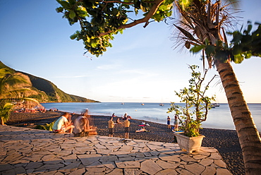 Long exposure shot of group of tourists at Black Sand Beach, Basse Terre, Guadeloupe