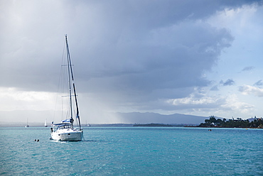 View of single sailboat anchored in sea, Gosier, Guadeloupe