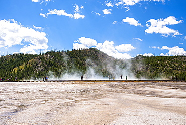 Scenic view of Midway Geyser Basin with tourists in the distance, Yellowstone National Park, Wyoming, USA